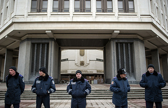 Police guarding the parliament building in Crimea's Simferopol