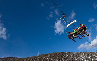 Skiers use a ski lift in the winter sport resort of Bansko, Bulgaria