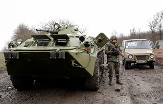 Ukrainian soldiers with military vehicle patrol a road between Luhansk and Slavyansk