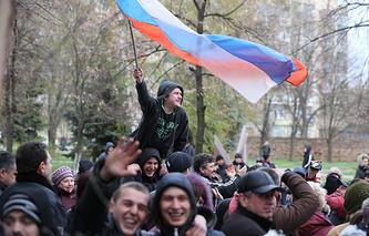 Protester waving a Russian flag in east Ukraine's Slavyansk