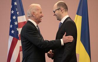 US Vice President Joe Biden talks with Arseniy Yatsenyuk
