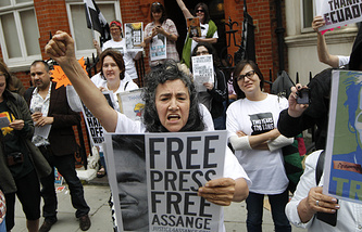 Supporters of WikiLeaks founder Julian Assange hold a vigil outside the Ecuadorian Embassy in London on June 19