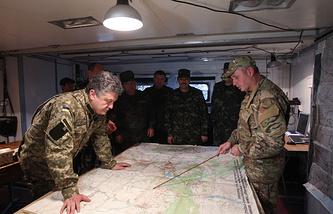 Ukrainian president Petro Poroshenko (left) at the center of the military operation on June 20