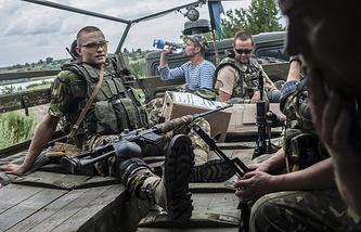 Ukrainian sappers ride on a truck