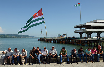 Opposition activists seen with the national flag of Abkhazia  (archive)