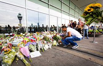 Flowers left in commemoration for the victims of Malaysian Airlines flight MH17 at Schiphol Airport, near Amsterdam