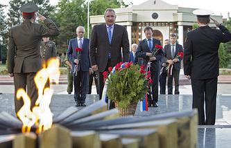 Rogozinlays flowers at the memorial complex 'Eternity' in Chisinau, Moldova