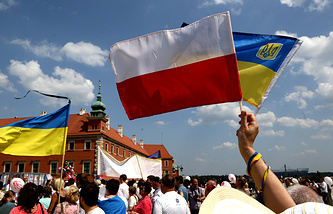 Polish and Ukrainian national flags seen at a demonstration in Warsaw
