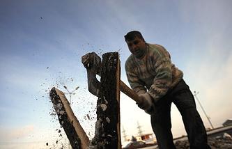 A man chops firewood in Sofia, Bulgaria