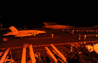 F/A-18E Super Hornet reparing to launch from the flight deck of the aircraft carrier USS George H.W. Bush