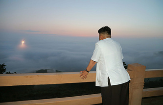 North Korean leader Kim Jong-un witnesses the launch of a ballistic missile at an undisclosed location in North Korea