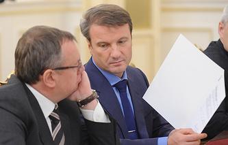 VTB head Andrey Kostin (L) and Sberbank CEO German Gref (R)