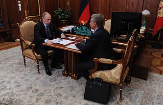 Russia's President Vladimir Putin and Novatek's CEO Leonid Mikhelson