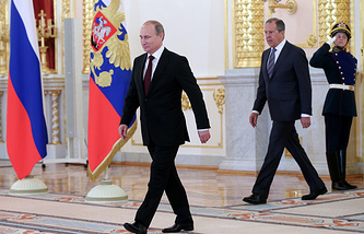 Vladimir Putin (center) and Russian Foreign Minister Sergey Lavrov (right) during the ceremony  of presenting credentials on June 27, 2014