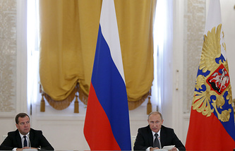 Dmitry Medvedev (left) and Vladimir Putin