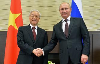 Russian President Vladimir Putin (R) shakes hands with Vietnamese Communist Party Secretary General Nguyen Phu Trong