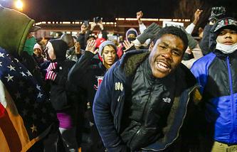 Protestors outside police headquarters in Ferguson, USA