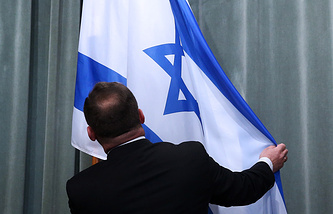 An Israeli flag seen ahead of a joint press conference of Israeli and Russian foreign ministers