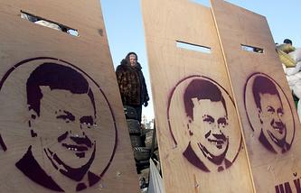 Portraits of Ukraine's ex-president seen on opposition barricades during Maidan rallies in Kiev, Jan 2014