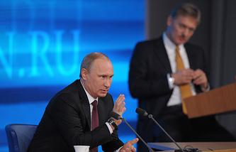 Vladimir Putin and Dmitry Peskov
