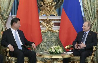 Vladimir Putin (right) and Xi Jinping
