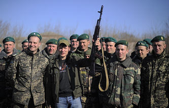 Leader of Ukraine's Radical Party Oleh Lyashko (holding a rifle) poses with Ukrainian soldiers