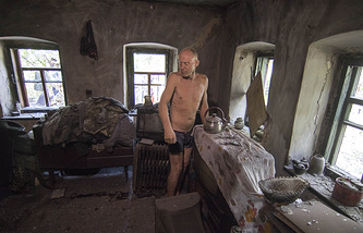 A man in his house destroyed by shelling in Mariupol, Aug. 17