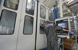 Worker at an engine-building plant