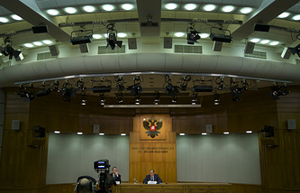 Russian Foreign Minister Sergey Lavrov listens to a question during a news conference