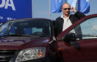 Vladimir Putin and a Lada Granta car, May 2011