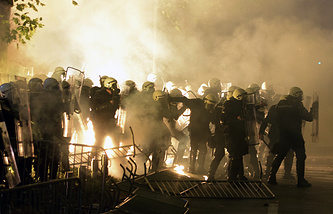 Montenegrin riot police officers seen during clashes with anti-government protesters in the capital Podgorica, Montenegro