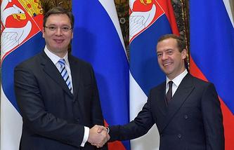 Aleksandar Vucic (left) and Dmitry Medvedev (right)
