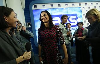 Yelena Isinbayeva during a news conference at TASS