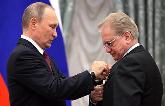 Russian President Vladimir Putin and Hermitage Museum director Mikhail Piotrovsky