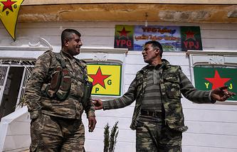 Kurdish militia members