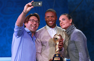 Russia's two-time Olympic Champion Yelena Isinbayeva, Brazilian football star Julio Baptista, Russian TV host Andrei Malakhov