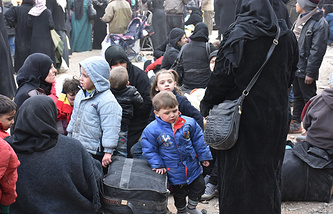 Syrians in eastern neighborhoods of Aleppo