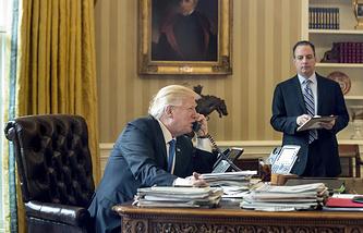 President Donald Trump, accompanied by Chief of Staff Reince Priebus