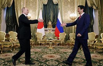 Vladimir Putin and Shinzo Abe