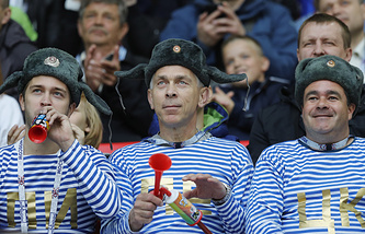 Russian fans wearing telnyashka striped shirts and Ushanka hats seen at Spartak Stadium in Moscow