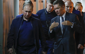 Russian President Vladimir Putin and Gazprom CEO Alexei Miller aboard the Pioneering Spirit pipeline-laying vessel