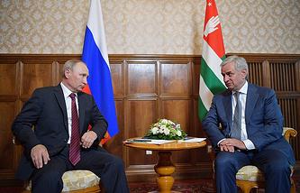 Russian President Vladimir Putin and Abkhazian President Raul Khadjimba
