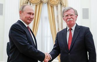 Russian President Vladimir Putin and US National Security Adviser John Bolton