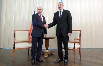 Russia's President Vladimir Putin and Azerbaijan's President Ilham Aliyev