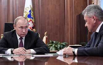 Russian President Vladimir Putin and Russian Defense Minister Sergei Shoigu