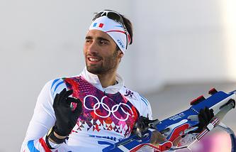 Мартен Фуркад после завершения гонки на 20 км по биатлону