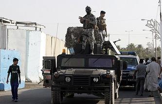 Иракские полицейские в Багдаде