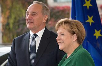 Андрис Берзиньш и Ангела Меркель