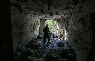 Последствия артобстрела по городским кварталам Донецка, август 2014 года