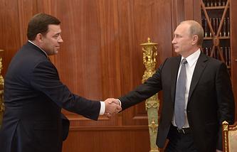 Президент РФ Владимир Путин и губернатор Свердловской области Евгений Куйвашев во время рабочей встречи в Кремле